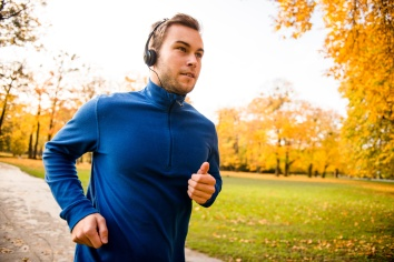 Man jogging and listening music